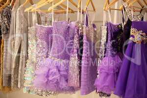 Glitter dresses in a closet/store