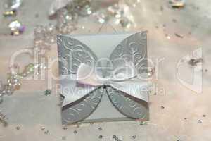 Elegant wedding invitation with a bow