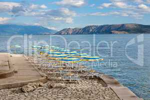 Beach with perfectly parallel lines of parasols