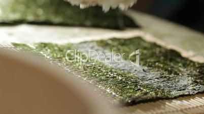 Putting rice on nori.
