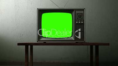 old TV with a green screen in the room
