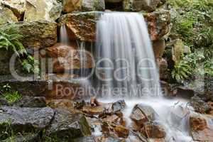 Small waterfall in a park in Georgsmarienhuette, Lower Saxony, Germany, Europe