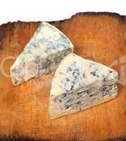 Dorblu cheeses on old wooden board