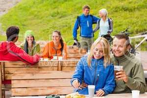 Friends having fun rest area drinking refreshments