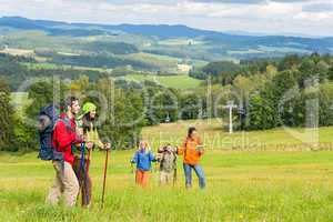 Young trekking people enjoying scenic landscape