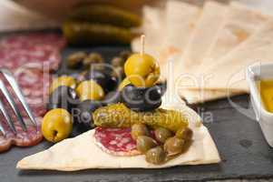 cold cut platter with pita bread and pickles