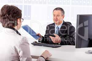 Businessman and businesswoman discuss business