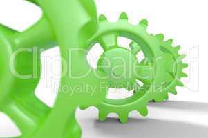 Grüne Zahnräder isoliert 3