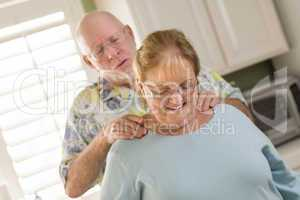 Senior Adult Husband Giving Wife a Shoulder Rub