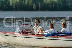 Men driving speed boat enjoying sunshine