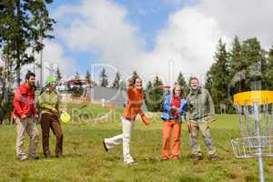 Group of friends playing with flying disc