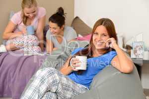 Teenager girls drinking at slumber party