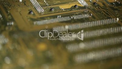 High technology background, computer circuit board. Focus pulling macro shot.