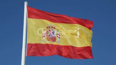 Spanish Flag waving against a blue sky