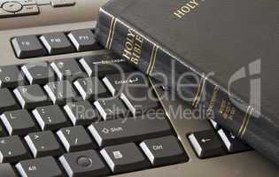 Holy Bible and keyboard