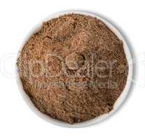 Ground pepper in plate isolated