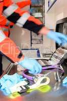Rushing paramedics with medical equipments
