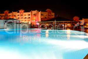 The swimming pool at luxury hotel in night illumination, Hurghad