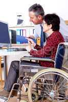 Woman in wheelchair can help in Office