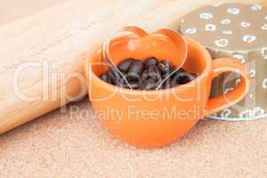 Heart cookies cutter in cup of coffee bean