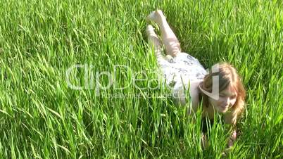 Happy girl in the grass