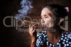 Old Asian woman smoking