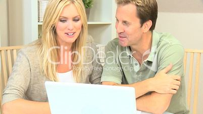Caucasian Couple Happy with Their Financial Planning