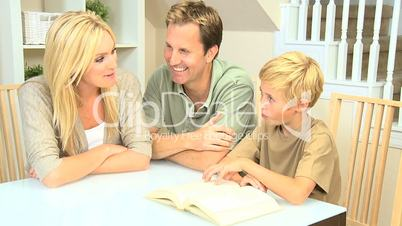 Young Parents Listening to Their Son Reading