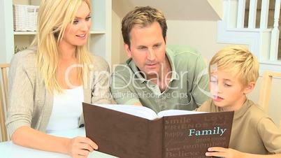 Young Caucasian Family with Photograph Album