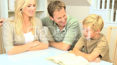 Caucasian Parents and Son Reading a Book