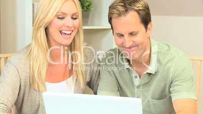 Modern Young Couple Using Home Laptop for Shopping