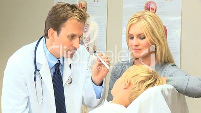 Young Blonde Boy with Doctor at Family Clinic