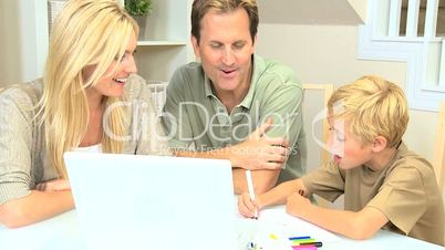 Young Blonde Boy with Parents Using Color Pens