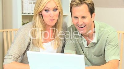 Blonde Couple Pleased with Laptop Online Success