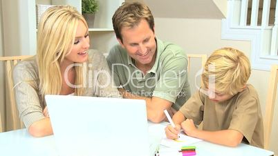 Couple Watching Son Doing School Project