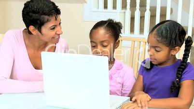 Little Ethnic Girls Using Laptop Computer