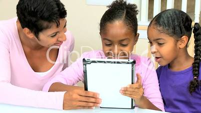 Cute Little African American Girls with Wireless Tablet