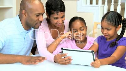 Little Ethnic Girls Using Wireless Tablet with Parents