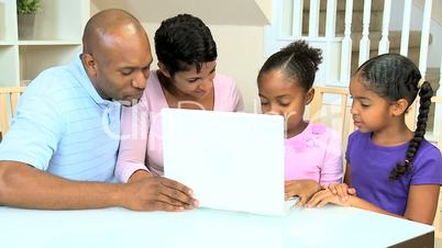 Cute Little African American Girls Playing on Laptop