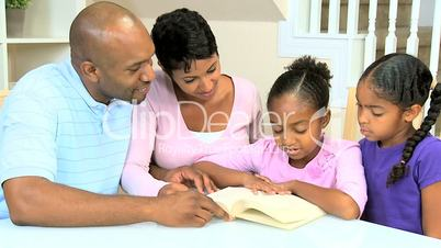 Little Ethnic Girl Reading with Family