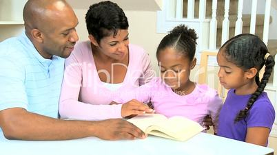Little African American Girl Reading with her Family