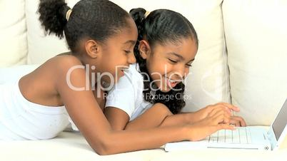 African American Girls Playing on Laptop