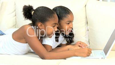 African American Girls Playing on Laptop