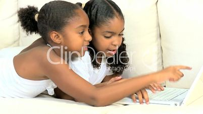 Little Ethnic Girls Playing on Laptop