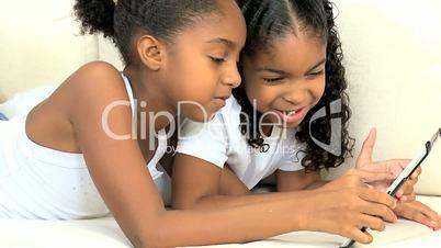 Ethnic Children with Modern Wireless Tablet