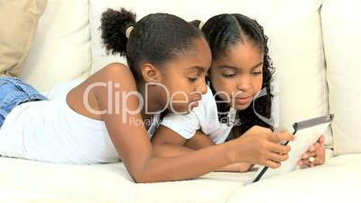 Little Ethnic Girls with Wireless Tablet