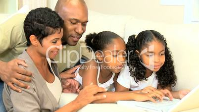 Little Ethnic Girls Using Laptop Computer with Parents