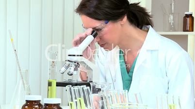 Science Research Assistant Using Microscope