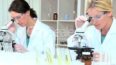 Female Medical Researchers in Lab