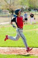 Teen baseball boy running